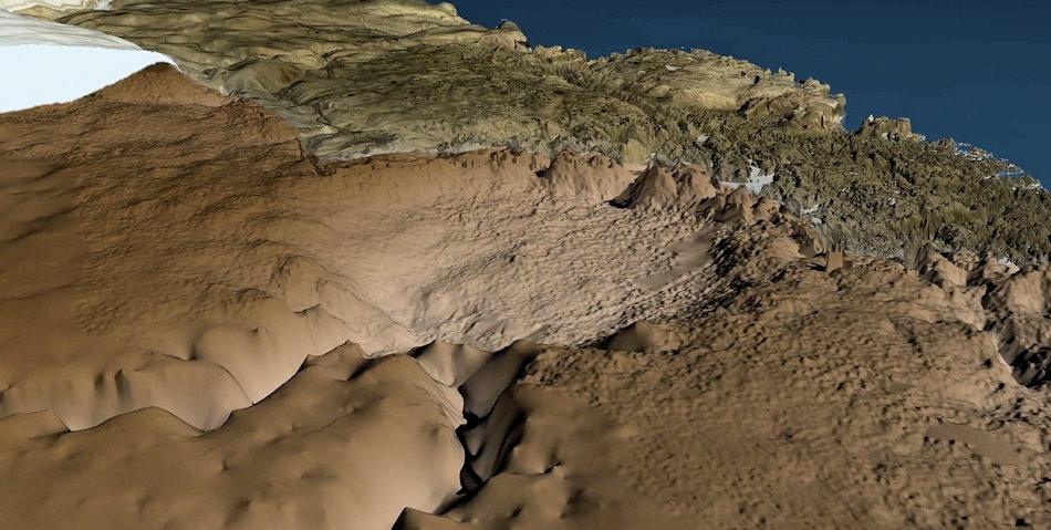 Karte der Untergrund-Topographie unter dem Eisschild und der eisfreien Umgebung des Hiawatha Einschlagkraters. Der Blick geht nach Westen in Richtung Nares-Strasse und Ozean. Der Krater selbst hat einen Durchmesser von mehr als 31 Kilometer. Bild: Natural History Museum of Denmark